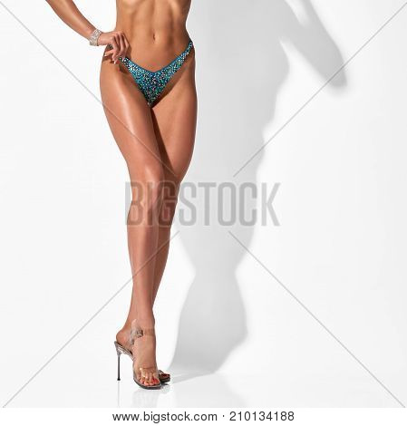 Closeup of healthy fit female body and smooth legs