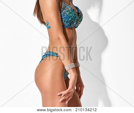 Closeup of slim healthy part woman's body on white background