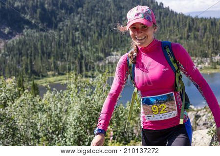 ERGAKI, RUSSIA - AUGUST 05 2017: Unknown girl walks the mountains, participant of the TRAILING contest SKAYRANFEST August 5, 2017 in the Ergaki National Park, Russia