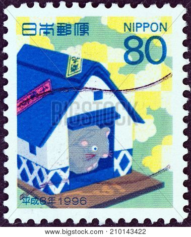 JAPAN - CIRCA 1995: A stamp printed in Japan shows mouse in a rice barn (Year of the Rat, 1996), circa 1995.