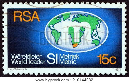 SOUTH AFRICA - CIRCA 1977: A stamp printed in South Africa shows Metrication Symbol on Globe, circa 1977.