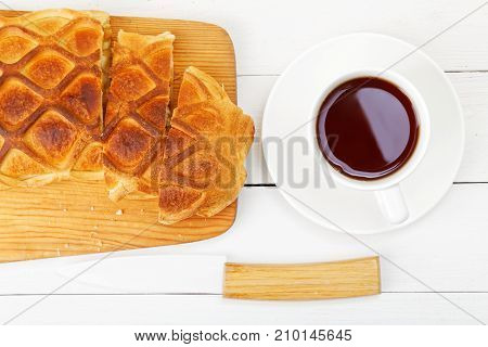 Closeup Strudel With Apples And Cinnamon On White Wooden Table