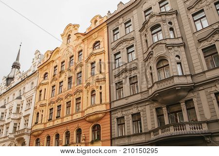 Beautiful historic buildings standing tightly together. Traditional facade of buildings, exterior of buildings in Prague.