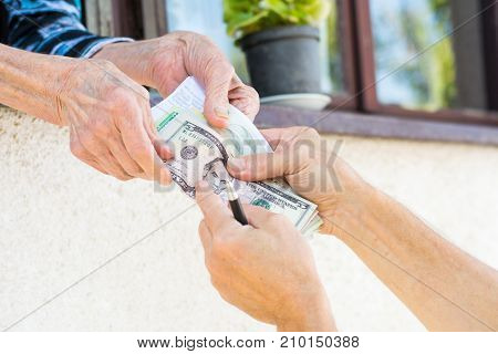 Grandma Receiving Retirement Money At Home