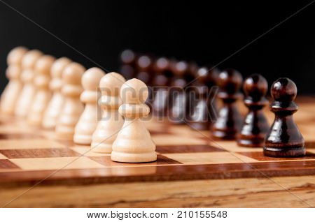 Still Life On The Chessboard: White And Black Pawns Stand In A Row