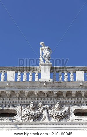 National Library of St Mark's (Biblioteca Marciana) statue at the top. Venice Italy. It is one of the largest libraries in Italy. It has one of the most important collections of Greek Latin and Oriental manuscripts.