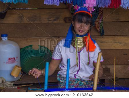 KAYAN STATE MYANMAR - SEP 09 : Portrait of a Kayan tribe woman in Kayan state Myanmar on September 09 2017 Kayan tribe woman are well known for wearing neck rings.