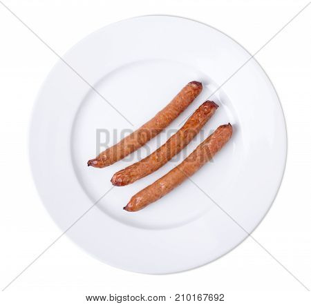 Closeup of fried sausages on a plate. Isolated on a white background.