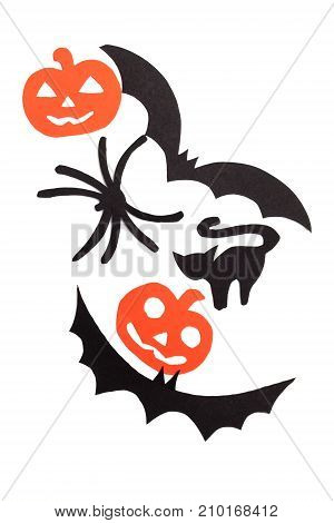 Silhouettes of black volatile bats, cats, orange pumpkins, cats and spider carved out of black paper are isolated on white for Halloween festival. Halloween concept poster