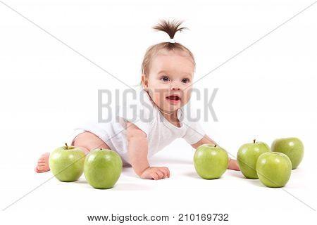 Cute Cheerful Little Girl In White Shirt Near Apples