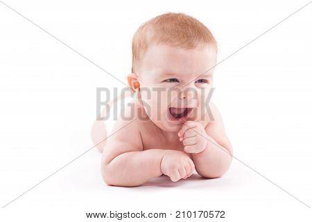 Beauty Little Boy In White Diaper Lies On Belly
