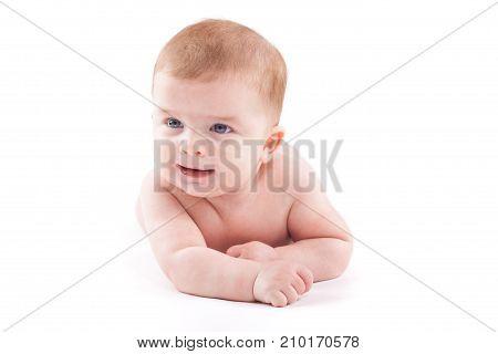 Cute Pretty Little Boy In White Diaper Lies On Belly