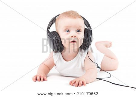 Cute Pretty Baby Boy In White Shirt And Headphones On Head