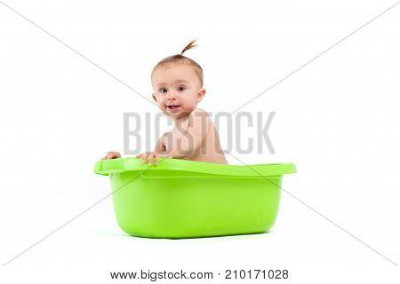 Happy Cute Baby Girl Take Bath In Green Tub