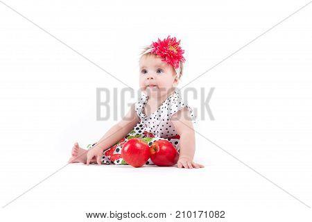 Cute Pretty Little Girl In Butterfly Dress Near Red Apples
