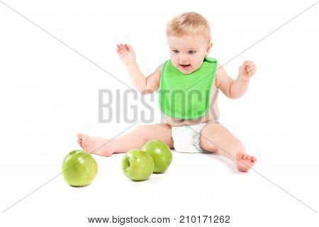 Cute Happy Little Boy In Green Bib Play With Apples