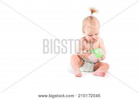 Cute Beauty Little Girl With Baby Bottle