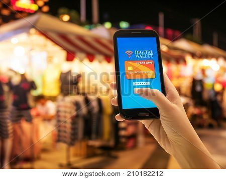Digital mobile wallet internet banking modern technology and online transaction idea. Smartphone screen with wallet and credit cards on screen for convenient and fast pay and buy goods and service