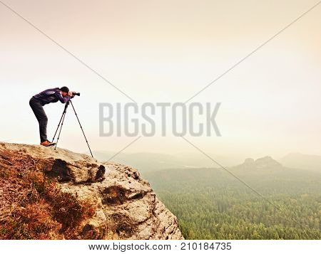 Nature Photographer Prepare Camera To Takes Impressive Photos Of Misty Fall Mountains. Tourist Photo