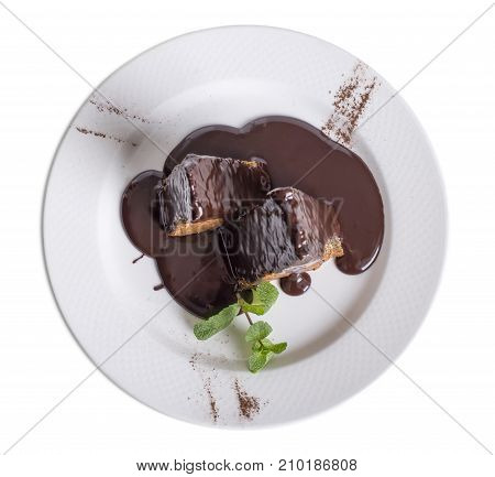 Delicious cake with chocolate sauce. Isolated on a white background.
