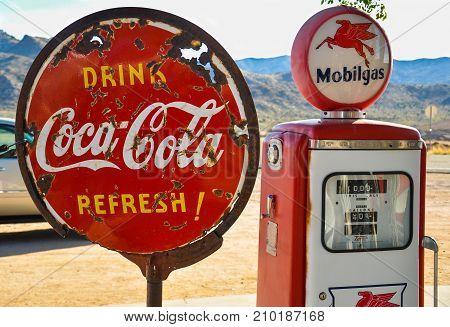 ROUTE 66, ARIZONA, USA - MAY 15, 2013: Retro gas pump and a rusty coca-cola sign on historic route 66 in Arizona.