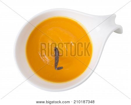 Pumpkin cream soup with vanilla aroma. Isolated on a white background.