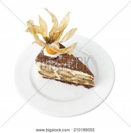 Delicious tiramisu cake with physalis. Isolated on a white background.