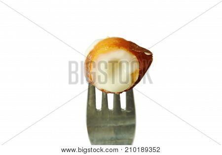 fried chicken sausage stuffed cheese slice and stabbing in fork on white background