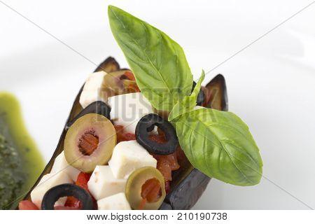 Sicilian style sicilian eggplant caponata with tofu and pesto sauce. Macro. Photo can be used as a whole background.
