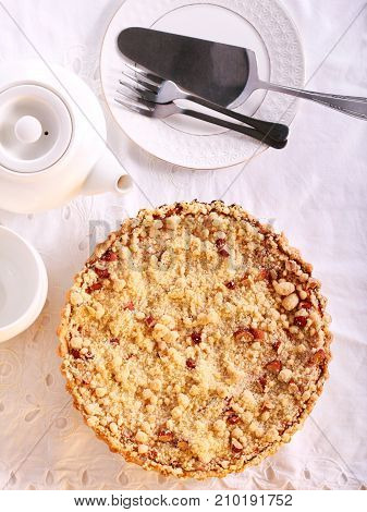 Streusel topping cake served on table overhead shot
