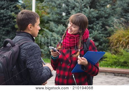 Boy And Girl Exchanging Phone Numbers