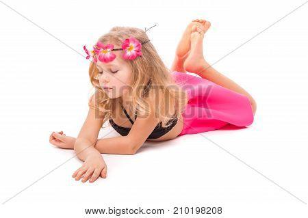 Attractive Little Girl In Black Bikini, Pink Skirt And Pink Wreath, Lies