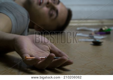 A Guy Is A Drug Addict Lying On The Floor After Taking A Dose. Death Of A Drug Addict