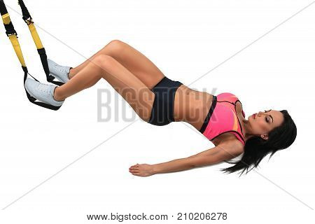 Woman exercising with suspension straps isolated on white background.