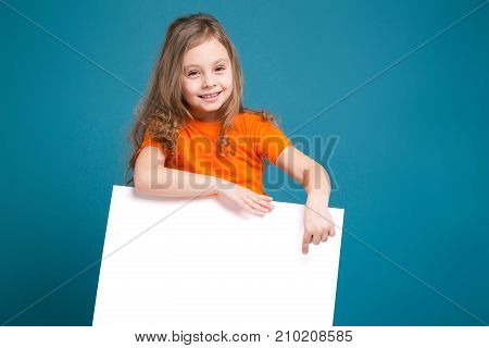 Cute Little Girl In Tee Shirt With Brown Hair Hold Clean Paper