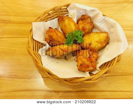 Deep fried barbecue chicken wings or buffalo wings serve in the bamboo basket for appetizer