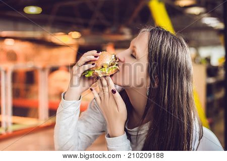 Young Woman Eating Hamburger Woman Eating Junk Food, Fatty Food Hamburger