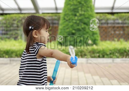 Japanese Girl Playing With Bubble (2 Years Old)
