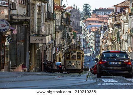 PORTO, PORTUGAL - MAR 4, 2017: On one of the streets in old downtown. City of Porto was elected from 20 selected Best European Destination 2017 and won this prestigious title.
