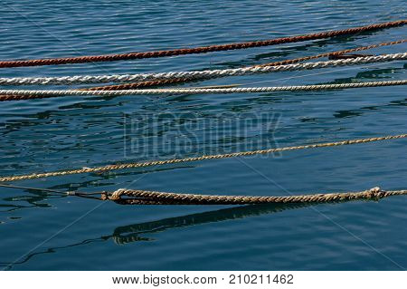 Close up view of mooring ropes and colorful cables