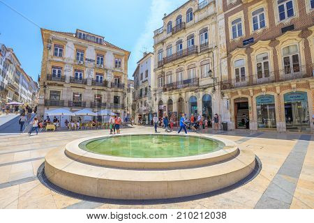 Coimbra, Portugal - August 14, 2017: fountain in Praca Oito de Maio or Terreiro de Santa Cruz, a square in lower Coimbra, the medieval part of city. Coimbra is known for oldest university in Portugal.