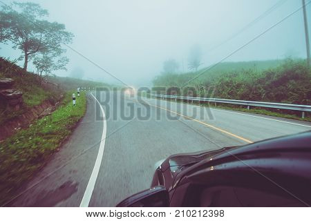 Landscape road paved road Rural Roadside View Mountain View. Road transport road. Car running on the street. Fog on the street