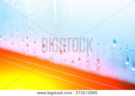 High Humidity, Condensing Large Drops Of Condensed Water Flow Down The Glass. Texture Of Water On A