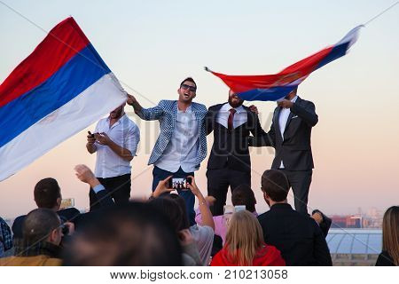 Moscow, Russia - Sep 23, 2017: The tourists waving flags in the Sparrow hills