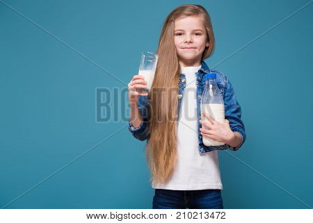 Little Pretty Girl In Jean Jacket With Long Brown Hair Hold Milk Container