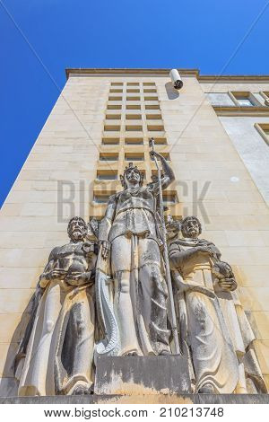 Coimbra, Portugal - August 14, 2017: close up of statues on facade of Faculdade de Medicina of Coimbra or Faculty of Medicine of the oldest University of Portugal. Bottom view upwards.