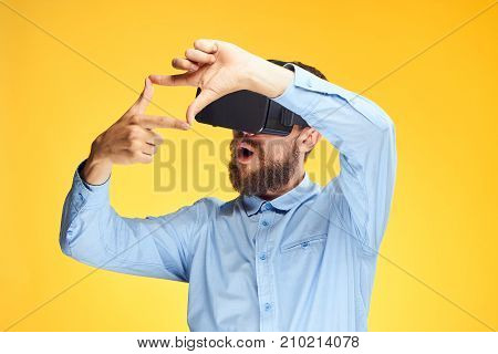 man in 3d glasses on a yellow background portrait, virtual reality games.