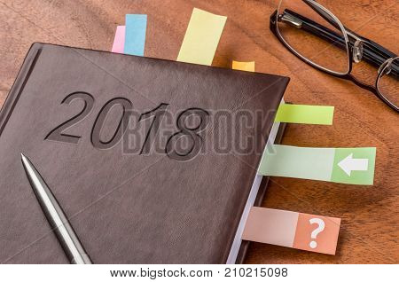 A notebook on a desk Year 2018