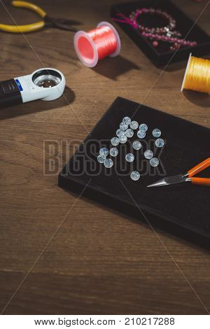 Tools for jewelry making colorful stone beads. Jewellry workplace.