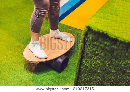 Women on Deck for balance board. Rocker-roller boards. oval wooden deck for balance board. roller for balance board. Rocker-roller boards.